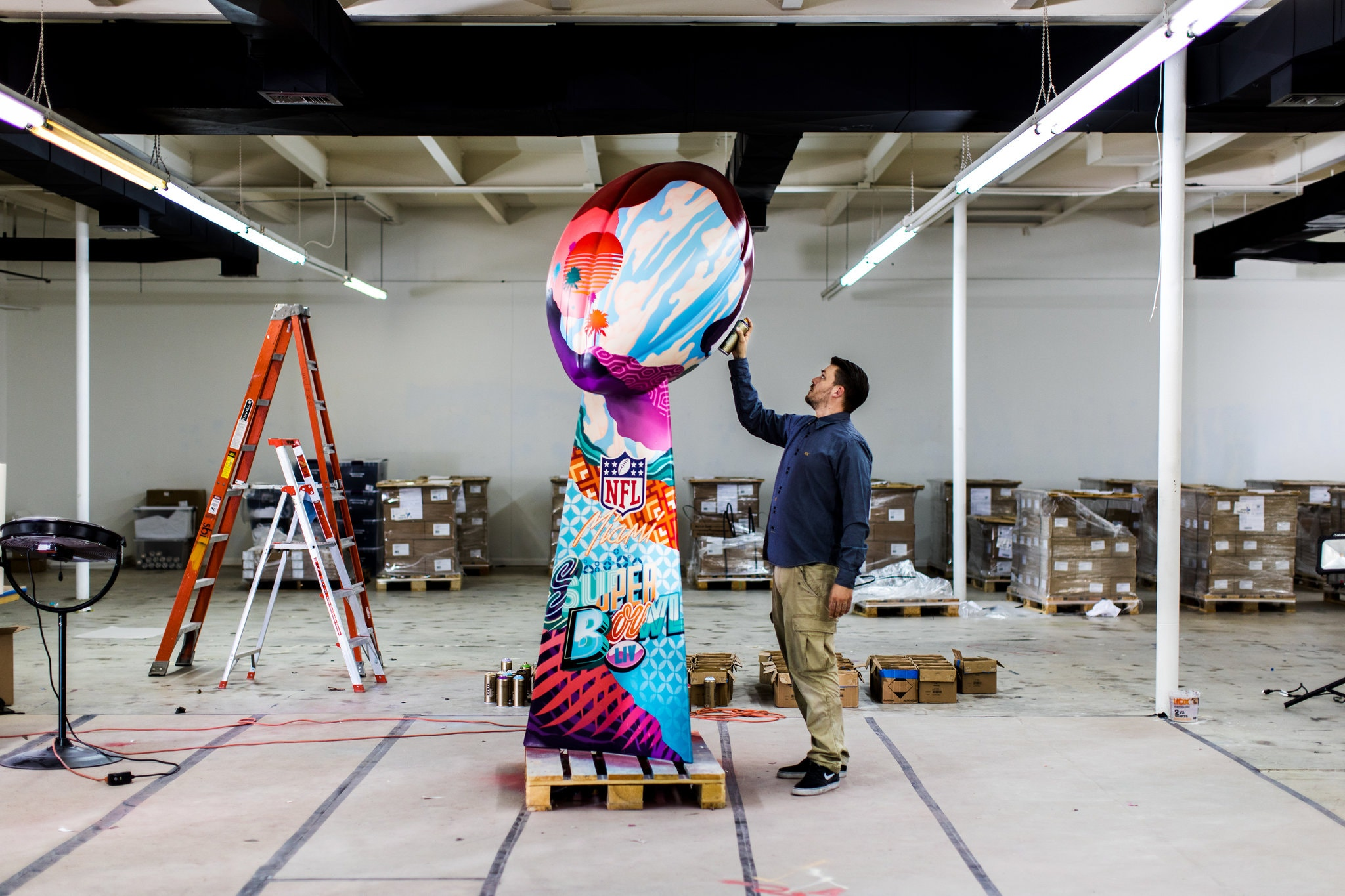 Tristan Eaton Spray Paints 9-Foot Tall Model of Lombardi Trophy for Super Bowl LIV